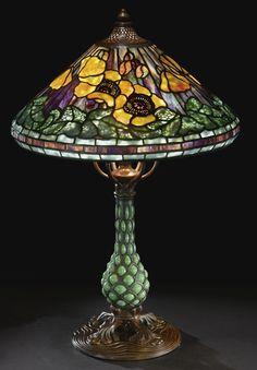 "1905 Tiffany Studios  A SUPERB ""POPPY"" TABLE LAMP TIFFANY STUDIOS ~ reticulated blown glass ""Pineapple"" base shade impressed TIFFANY STUDIOS NEW YORK 1467 base impressed TIFFANY STUDIOS/NEW YORK/25872, SOLD. 188,500 USD"