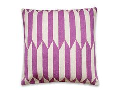 USING THE CREWEL STITCH TECHNIQUE, INDIAN WOMEN ARTISANS CREATE THESE GEOMETRIC-PATTERNED PILLOW CASES, DESIGNED BY LEAH SINGH.