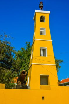 Kralendijk Lighthouse, Fort Oranje was built in 1932 in the capital city Kralendijk on the island of Bonaire in the Caribbean Netherlands. Fort Oranje was built in 1639 to defend Bonair's main harbor. Porto Rico, Lighthouse Pictures, Southern Caribbean, Beacon Of Light, Mellow Yellow, Bright Yellow, Cruise, Scenery, Around The Worlds