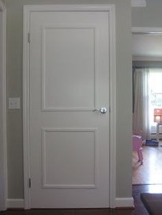 add cheap dollar store picture frames to flat hollow doors for a panel look--super cheap and looks good.