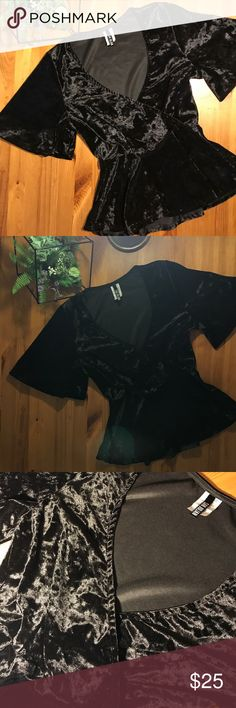 Sexy Black Velvet Peplum Top Get yourself fall Ready with these super sexy black velvet Peplum top. These are super HOT!  Get them before they are gone!! Cute bell sleeves and plunging neckline! Bundle and save 😏 Tops Blouses
