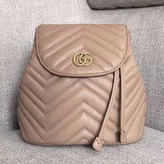 31788c6a541a Gucci GG Marmont Matelasse Backpack 528129 -Size  cm -Matelasse chevron  leather with a vintage effect -Antique gold-toned hard.