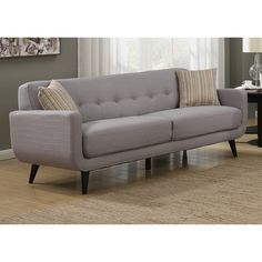 Update your living room furniture with the Crystal sofa and add a bit of mid-century modern style to your home decor. Crafted from wood with light grey polyester fabric and tufted back rests for added