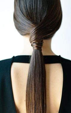 brush your hair back with a comb. Leave out a one-inch section of hair on each side and pull the rest back into a taut pony. Lastly, gather one section, wrap it around the elastic and secure with bobbies. Repeat on the other side, wrapping it around the opposite direction.