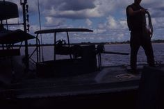 A PBR (Patrol Boat River) on patrol in a river in the Delta Region of Vietnam