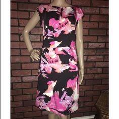 """Ann Taylor SS silk floral dress 4 Worn once to a wedding! Beautiful dress that can be worn for dressy events like a baby christening, wedding or even church! Front has a semi-faux wrap that comes down from chest and wraps around side. 100% silk. Rear zipper w/ hook closure, interior completely lined. Approx 15"""" bust, 15"""" waist, 18"""" hips, 22"""" length from waist. Excellent pre-loved condition! ✅offers❌trades/PP bundles save 20% off 2+ Ann Taylor Dresses"""
