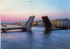 Russia - St Petersburg - Palace Bridge.Peter the Great was designing the city as another Amsterdam and Venice, with canals instead of streets and citizens skillful in sailing. Every night during the navigation period from April to November, 22 bridges across Neva and main canals are drawn to let ships pass in and out of the Baltic Sea