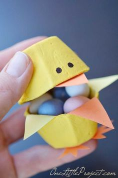 Egg Carton Chicks: The best part about these tiny egg carton chicks is that they're filled with candy. Click through to find more simple, easy and fun Easter crafts to make with your kids.