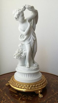 Check out this item in my Etsy shop https://www.etsy.com/listing/269073728/sevres-figurine-antique-bisque-figure