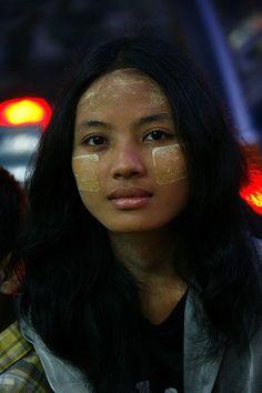 Girl with thanaka at chinese night market, Myanmar