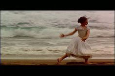 Flora dances on the beach to her mother's piano in her undergarments - at this moment she is careless and free, surrounded by nature and beauty. This is in contrast to the claustrophobic setting of the forest and house they live in, where all propriety must be observed.