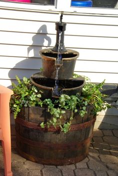 Turn A Whiskey Barrel Into A Gorgeous Three Tiered Fountain