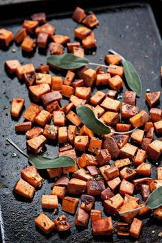 The Best Roasted Sweet Potatoes (with Garlic and Sage): Cubed sweet potatoes tossed in olive oil, salt, and pepper are roasted and then tossed generously with fresh garlic and sage. #sweetpotatoes #roastedpotatoes #roastedsweetpotatoes #sweetpotatorecipe Roasted Sweet Potato Cubes, Sweet Potato Quinoa Salad, Grilled Sweet Potatoes, Sweet Potato Recipes, Healthy Thanksgiving Recipes, Healthy Recipes, Winter Recipes, Meatless Recipes