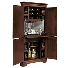 695-111 Norcross Wine & Bar Cabinet This Hide-A-Bar cabinet has Americana Cherry finish on select hardwoods and veneers. This handsome corne...