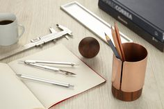Ditch the cheap industrial office supplies for Deniable Studio's collection of stationary designed to flatter your desk top with a refined material combinations of wood and