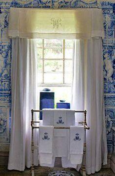 Blue & white tiles w/ white linens