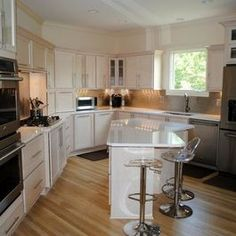 Contemporary Kitchen Remodel with Champagne Stain Maple Cabinets by Hatchett Design/Remodel