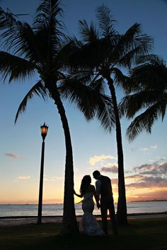 A gorgeous silhouette of the bride and groom in front of the Hawaiian sunset. LucieXYZ Photography.