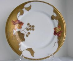 Up for your consideration today is this set of 4 magnificent plates. These are beautifully hand painted by the Limoges firm of Lazeyras, Rosenfeld & Lehman Co. on blanks from Coiffe Limoges dated fro