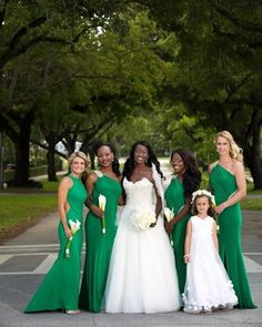 Funmi and her #munabridesmaids were truly gorgeous in those green gowns! What color(s) will your #bridesmaids wear? _ wedding gown: @lazaro // bridesmaids dresses: Nicole Bakti // photo: Ambrosio Photography // More from this wedding featured on the blog. (Search Funmi Ryan) #munaluchi #munaluchibride #greenwedding #bridesmaids