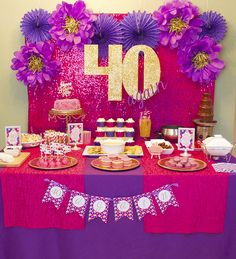 40 Again! 40th Birthday Party Celebration. Hot pink, purple and gold combine for this bright and beautiful birthday party theme.