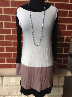 SZ: S-L $44  COLOR BLOCK black, cream & beige tunic is an eye catcher this season! Will look great with a pair of black leggings!!!