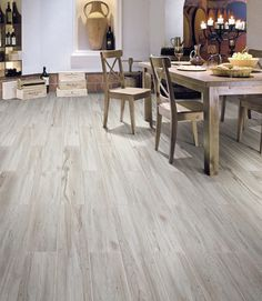 Don't be fooled into thinking these are wood floors! This robust all-purpose porcelain tile brings a rustic and natural plank style of flooring, in five classic wood tones, into your living space. A glazed tile collection with a matte finish, the Rustic Cariboo Series provides you with outstanding digital technology tiling and the look of authentic wood grain. Click thru to order up to 5 FREE samples, we'll even pay for shipping.