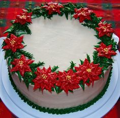 - I made this cake as a my contribution to the dessert table at my husband's family potluck for Christmas Day. All decoration is piped in buttercream. I sprinkled a tiny bit of gold hologram dust over the poinsettias for a glittery effect. Christmas Cake Designs, Christmas Cake Decorations, Christmas Sweets, Holiday Cakes, Xmas Cakes, Christmas Christmas, Christmas Wedding, Holiday Baking, Christmas Baking