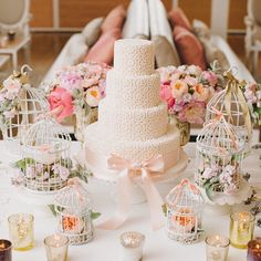 In love with this pretty pastel dessert table. Love how the flowers are caged giving it a rustic feel while keeping the main point on the lovely cake. Beautiful isn't? Would you decorate your dessert table like this? Leave us a comment if you do!  Dessert Table: @bobbetteandbelle / Designer: @melissaandreinc  Follow our sister accounts:  @theBrideStory @theBrideBestFriend @SparkleandGlamour
