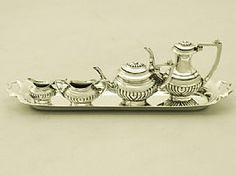A very good vintage English sterling silver miniature Queen Anne style four piece tea & coffee service with a matching tray- Boxed; part of our silverware collection http://www.acsilver.co.uk/shop/pc/Sterling-Silver-Miniature-Queen-Anne-Style-Tea-Coffee-Service-with-Tray-Boxed-Vintage-97p3156.htm