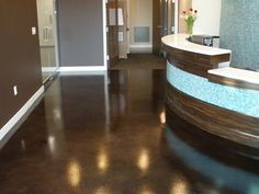 The foyer floor of this commercial building is stained with rich brown hues. Featured 3/14/13.  Browns Services Incorporated Woodbridge, VA