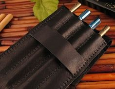Titanium Ti Sushi Sticks are precision 100% USA made chopsticks that unscrew in the middle and fit into a soft leather carrying case. TiSushi Sticks Tucked Away Safely
