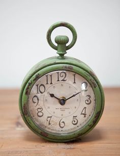 In love with the style and patina of this little clock!  It could add to just about any prim grouping...    ;)
