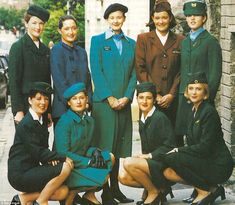 Aer Lingus flight attendants model uniforms from the past. The original uniform is pictured in the back row, second from right Vintage Photographs, Vintage Photos, Flight Sale, Croydon Airport, European Airlines, Dublin Airport, Airline Uniforms, Isle Of Man, Cabin Crew
