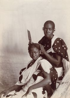 "Photographs from Distance and Desire: Encounters with the African Archive: http://nyr.kr/10VCuoK This photo: A.C. Gomes & Sons (attr.), inscribed: ""Natives Hair Dressing, Zanzibar,"" Tanzania, late 19th c."