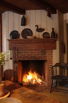 Cozylicious! I'd love to have a fireplace in the kitchen, especially if it had a brick bread oven along with it.
