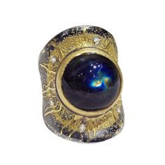 Zobel Spectrolite Diamond Silver Gold Burst Ring. One-of-a-Kind, Handcrafted Cosmic Burst Ring in 24k gold, 22k gold, and oxidized sterling silver with a spectacular cabochon-cut spectrolite (11.50cts) and champagne diamond accents (0.06tcw).  Germany, 2014