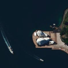 "dailyoverview: ""The Sydney Opera House hosts more than 1500 shows each year in its various performance halls drawing a total attendance of approximately 1.2 million people. While the buildings famous shell design appears uniformly white from a distance it actually features a subtle chevron pattern composed of tiles in two colors: glossy white and matte cream."""