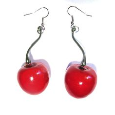 Make the most of summer with these gorgeous plastic cherry drop earrings! Perfect for festivals, picnics, vintage accessorising and just everyday fab and fun kitsch style.  Cherries measure approximately 25mm x 25mm. Very lightweight. Overall drop measures 55mm from top of stem. Silver tone metal alloy hooks. Colour is a medium cherry red. For pierced ears.