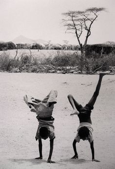 Children playing by refugee camp where they came to escape drought. Somalia 1980. by Chris Steele-Perkins