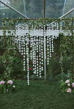 Brides.com: . A whimsical DIY ceremony altar wrapped in wild vines with hanging cone garlands, created by Firefly Events, Sullivan Owen and Rye Workshop.