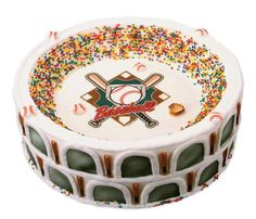 The idea of using sprinkles for the people in crowd is so cool.  Love this stadium cake.