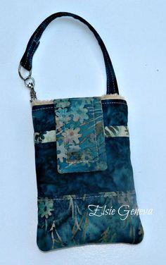 Batik Emerald Green / Teal and Tan Flowers and Leaves Batik Phone Case with Wristlet & Back Zipper Pocket. $33.00, via Etsy.