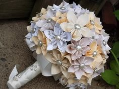 Wedding origami flowers... This is stunning and just as pretty as real flowers! I could totally see myself having this bouquet! so cheap and pretty!