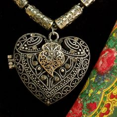 Portuguese folk aged silver metal Heart of Viana filigree style Locket pendant with vintage fancy necklace. Inspired in the Portugal traditional filigree jewelry used by country women in the north of Portugal. $75.00..#portuguesevianaheartnecklace#colarcoraçaodeviana#madeinportugal#helenaaleixo#memoriacoraçaodeviana#bigfiligreeheartlocket#portuguesefolkjewelry#portuguesefiligree#heartofvianajewelry#silverfiligreeheartpendant#portuguesenecklace