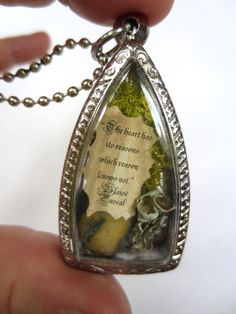 The Heart Has Reasons.... Love Pendant Miniature Message Locket Inspirational Message in a Bottle Lovers Gift. $29.00, via Etsy.