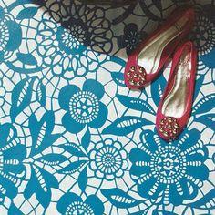 Pretty stenciled lace pattern on a concrete floor | Skylar's Lace Floral Stencil | Royal Design Studio