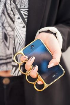 Love the knuckleduster/iphone case combo - although not really practical for a guy's back pocket.