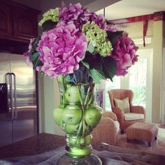 My mom's pretty flower arrangement with green apples and hydrangeas. Fresh and pretty for the kitchen!