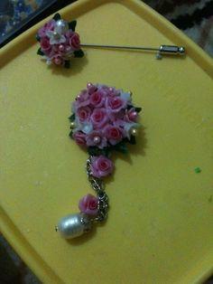 Pink--clay brooch n tuspin